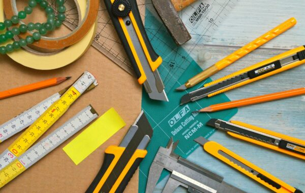 Work tools laid out on a desk