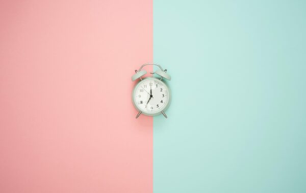 Clock with split background colour blue and pink
