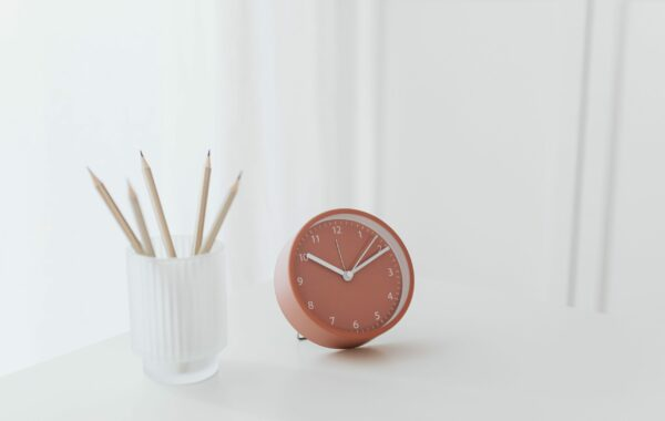 Small pink clock on desk