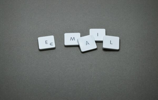 email written in scrabble pieces